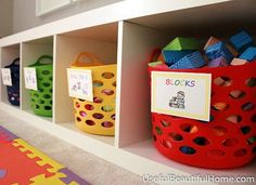"Organize Your Life with 12 Dollar Store Buys: Fun & Functional. For easier cleanup, head to the dollar store and pick up colorful baskets, then adorn with custom labels like these from ""Useful Beautiful Home"" to give your kids, even dogs, toys a home"