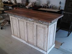 A kitchen island made from reclaimed doors