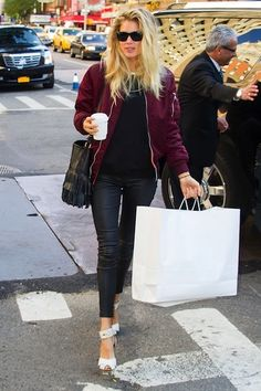 Doutzen Kroes <3 White shoes, fringe purse, ankle skinnies, maroon bomber jacket, black tee.