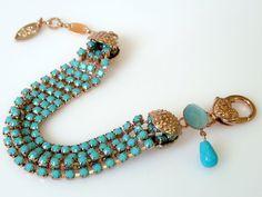 5 rows turquoise rhinestone bracelet, blue turquoise bracelet, rose gold, statement jewelry. by inbalmishan on Etsy https://www.etsy.com/listing/119149433/5-rows-turquoise-rhinestone-bracelet