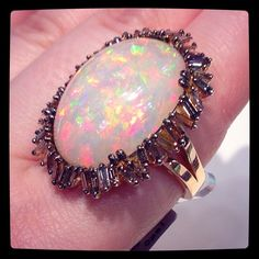 Opal and baguette diamond ring.