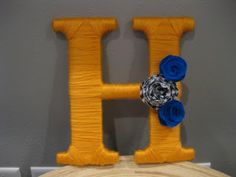 I've been pondering a good way to decorate our monogram- yarn wrapping might be it.