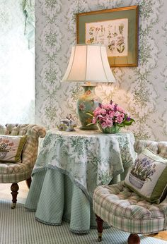 Overnight visitors at the King home are treated to a peaceful environment in the guest room, where there is a springlike mix of patterns. The Cowtan & Tout toile wallpaper provides a complementary backdrop to tufted slipper chairs covered in plaid from Scalamandré and a table skirt from Brunschwig & Fils.