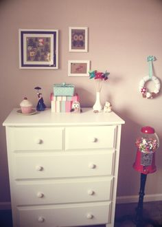 very sweet little girl's room - must steal some of the adorable accents.