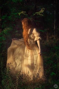 Love the straight from a fine art painting look. Love the accentuated long red hair. LOVE the lighting.