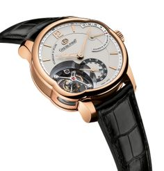 T24S: 5N red gold case and silvered gold dial. The T24S features a single inclined tourbillon cage. A distinctive asymmetrical case allows for a comfortable case size as well as an additional side window to further appreciate the tourbillon mechanism. http://www.greubelforsey.com/T24SI.asp