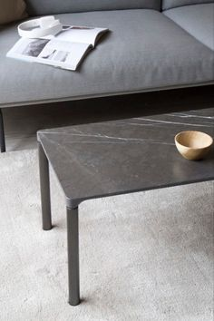 The impression is a single line floating on four delicate legs. The Piloti Table by Hugo Passos in stone ideal to place individually or together in a space to create a sense of continuity. Photograph by Hege Morris #fredericiafurniture #pilotitable #hugopassos #complements #craftedtolast #mogerninteriordesign #scandinaviandesign #danishdesign Nordic Interior Design, Scandinavian Design, Stone Table Top, Concrete Candle Holders, Danish Furniture, Mid Century Modern Furniture, Furniture Companies, Simple Elegance, Danish Design