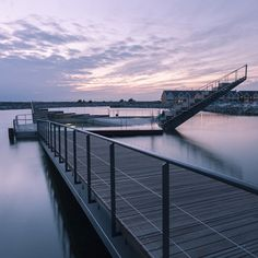 A series of new walkways and structures by Swedish firm White Arkitekter brings harbour swimming to Hasle – a town on a Danish island.