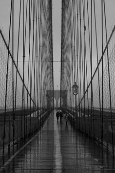 NYC. Rainy day on Brooklyn Bridge _______________ Good for perspective lesson - upper grades