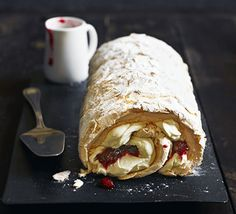 Work on your meringue skills to roll up this sensational dessert with tangy fruit, toasted almonds and vanilla cream filling