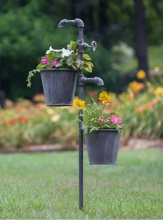 This double faucet garden stake gives the appearance that water could be running into the two plant holders hanging below. Made of weathered metal, this stake is full of country charm. The garden stak