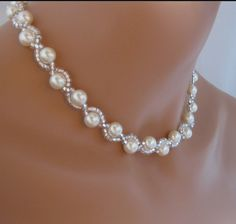 Ivory Pearl Bridal Necklace Wedding Jewelry Swarovski Pearl A beautiful necklace made up Swarovski ivory pearls and silver lined seed beads. Easy to bead with just some pearls and seed beads. Seed Beads 7 = 1 to attached pearls strand.