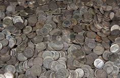 Pile of silver dime coins stock photo