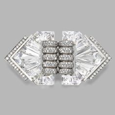 DIAMOND AND ROCK CRYSTAL DOUBLE-CLIP/BROOCH, MAISON HERZ, DESIGNED BY SUZANNE BELPERRON, CIRCA 1935. The pair of clips composed of carved rock crystal segments, set with round and old European-cut diamonds weighing approximately 5.45 carats, mounted in platinum and white gold, workshop mark for Groené & Darde, French assay marks.