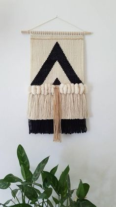 ◀Triangles. ▶The lines and contrasting colors will make a bold art piece in anyroom. Length 24 inches (stick to bottom of fringe) Width stick to stick 15 inches Colors: Off white, Black and tan Delicately Handwoven on a frame loom. Each woven wall hanging is made to order. Each item is a work of art and carfully made with pride and love. Natural wool roving Want a different color or have a different vision of a weaving. Contact the shop owner, Heidi to request a custom order! She is ...