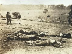 """""""A Harvest Of Death"""" Union dead on the Gettysburg battlefield. Original Gardner photo taken a few days after the battle reprinted by Tipton circa last quarter of the 19th century."""