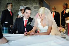 The gorgeous bride & groom signing their wedding certificate. #Dynamicearth #Bride&Groom #Thatdress #weddingceremony