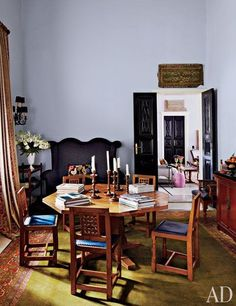 The dining room features an English Arts and Crafts table and chairs from Ann-Morris Antiques | http://archdigest.com