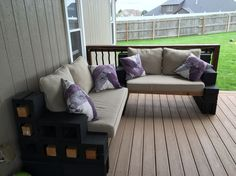 Look what I did!  Cinder blocks, concrete stain, a little wood and some cushions.