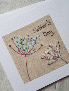 This pretty original textile Mother's day card has been designed and made by me. The textile artwork has been produced using appliqué and free motion machine embroidery, and has been attached to a hammered effect white greeting card. The card is blank inside for your own