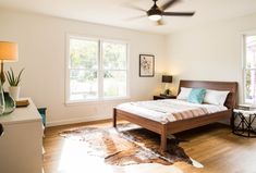 3208 Cherrywood Austin Mid Century Modern Bedroom with cowhide rug, Ikea Nyvoll bed
