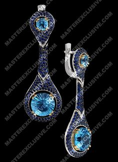 Earrings from the collection Solo. 14K yellow and white gold, topaz, blue sapphires.