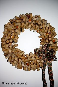 apply glue to the end of a toothpick, then push into a straw wreath. once it dries, push a cork into the other end