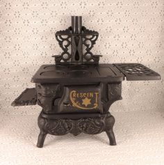 I have this, my grandma gave it to me when I was little. I used it with my Barbie's. Crescent Cast Iron Stove Black Small 1950s by RaindropVintageShop, $47.50