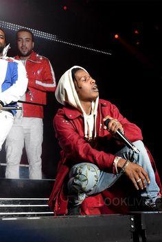 ASAP Rocky wearing  Raf Simons Eyelet Coat, Gucci Embroidered Denim Pants, Gucci Resort 17 Vintage Logo Hoodie