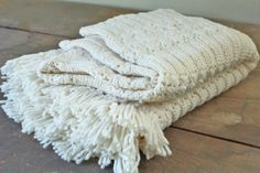 Vintage crocheted throw    Creamy white, sturdy and chunky    47 x 52 (without the 2 fringe edges)    In great vintage condition    Laundered
