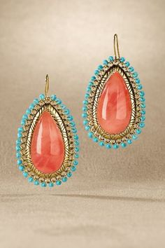 Stunning earrings capture the hypnotic mood and hues of a Southwestern sunrise. Designed with a lustrous teardrop cabochon in a setting of etched gold, surrounded by a filigreed border of seed beads. Sunrise Earrings #71534