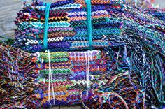 Wholesale lot of 12 narrow silk friendship bracelets Fair Trade schools team New