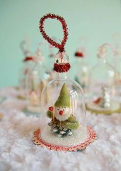 Cute made from top of plastic glassware, pine cone, pearl, and pipe cleaners. Very cute idea