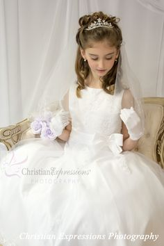 We just got in a new two tier, scalloped first communion veil with pretty white trim. Only $29.95 while supplies last (tiara sold separately) Visit our website or shop at our Rhode Island showroom www.firstcommunions.com Christian Expressions 245 Phenix Ave Cranston, RI