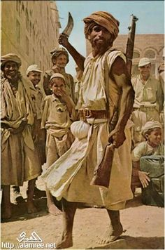 Yemeni man dance (baraa), 1955. Bara or Baraa dance is one of the several traditional outdoor dances performed by men in the country of Yemen. Bara dance literally means a dagger dance, where each dancer holds a dagger. (V)