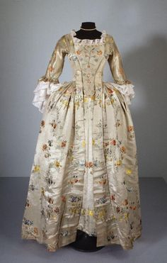 Robes à l'anglaise, c. 1765. Light green silk satin embroidered with multicoloured floral motifs.