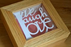 This cute mini 'Live Laugh Love' papercut design is created by paper petal. Framed in a handmade oak frame it features the short but sweet quote. Price: £25