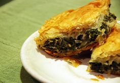 Spanakopita (Greek Spinach Pie)    This is an authentic, really rich pie stuffed with spinach, onions, cheeses and herbs that are all enfolded by crispy, flaky phyllo dough.