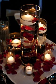 Floating candles and rose petals make easy wedding table decorations.