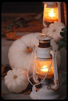 white pumpkins and vintage lanterns