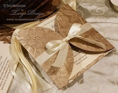 The Petal fold floral wrap design: Stunning Champagne and Gold wedding invitations, petal envelopes design available in elegant and