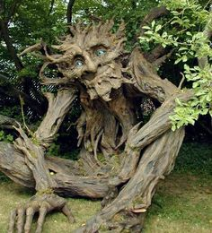 "This amazing 12 ft paper mache ""Tree Troll"" was made by Kim Graham and a group of 25 volunteers using recycled paper products."