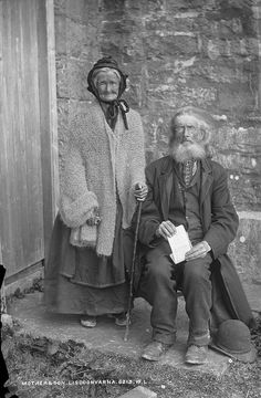 "An aging Irish man and his very elderly mother pose for an outdoor portrait in 1890. In his hands hands the gentleman holds a poem with the title ""Lines on Scenery round St. Bridget's Well in the County Clare"". #portrait #family #vintage #antique #Irish #Ireland #Victorian #1800s #1890s #19th_century"