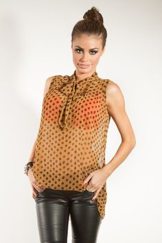 Chloe Sims From Towie wearing our Ochre Spot Chiffon Blouse! Yours for only £15.00.    Shop here:-http://www.pussycatlondon.com/womens-clothing-1/long-top-dresses/ochre-spot-chiffon-tie-blouse.html?color=Gold=8