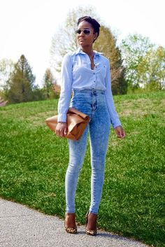 tuck a button-down shirt into your high-waisted jeans for a more sophisticated look