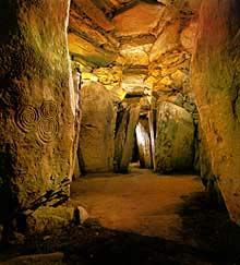 Inside Newgrange passage tomb, County Meath, Ireland...on Summer's Solstice the light shines in the entrance and lights up the Cathedral for about 14 minutes. This is older than the pyramids.