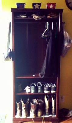 DIY mud room locker from 5 shelf bookcase. Curtain rod used to hang items inside and out.