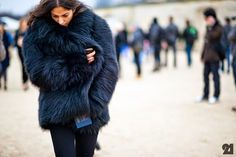 Is she FUR-real? Love this oversized navy fur jacket. Street style