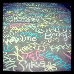 Write all of the new members' names in chalk outside of the house for Bid Day