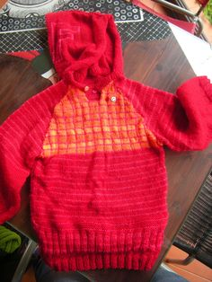 Sweater for kids.Knitted in red and orange wool.Barlume Manod'opera.